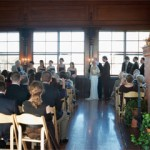 A couple take their wedding vows inside Kinney Bungalow