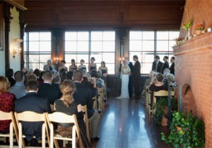A couple take their wedding vows inside Kinney Bungalow