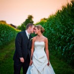 Couple in cornfield at sunset